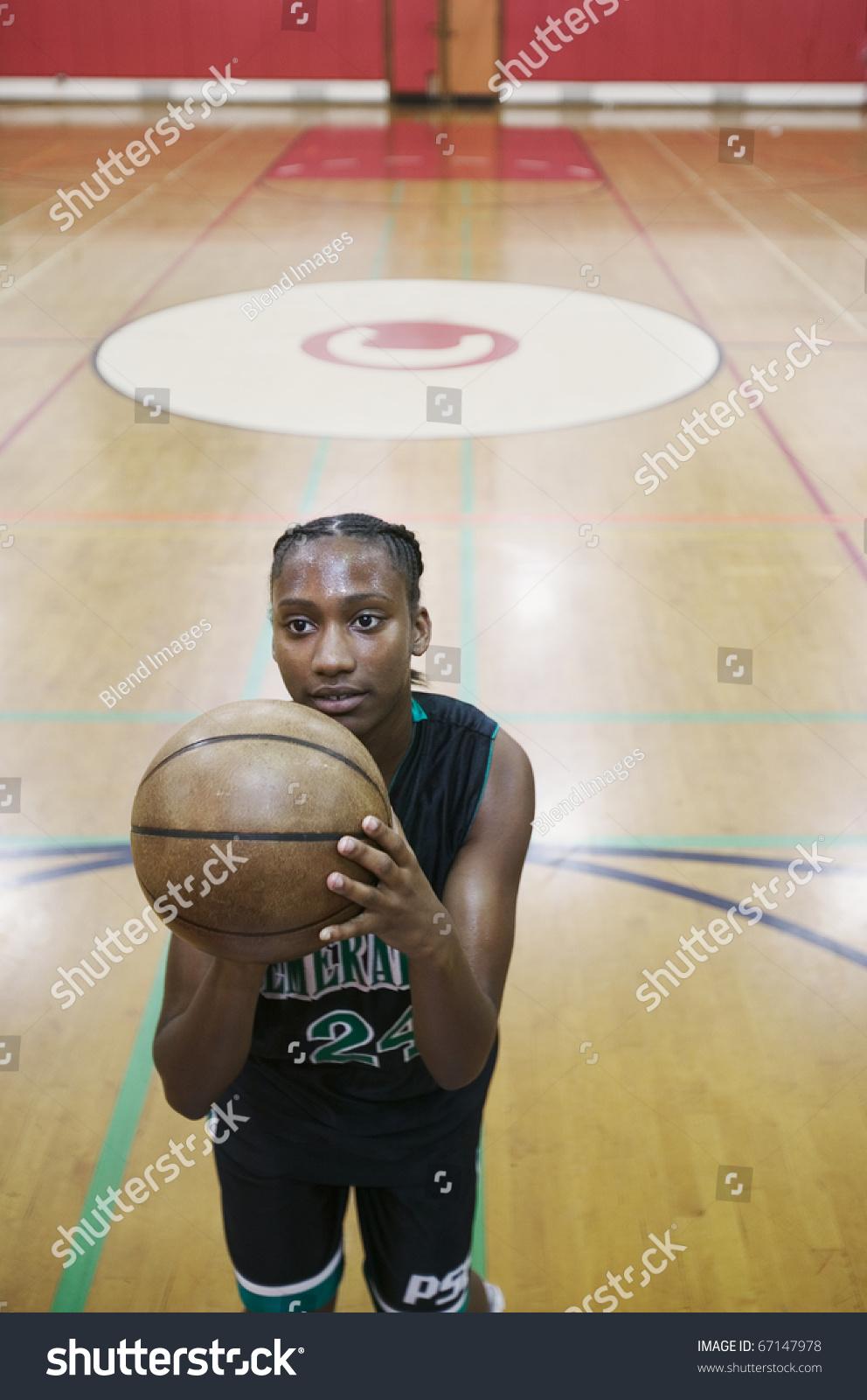 female basketball player shooting free throw stock photo 67147978