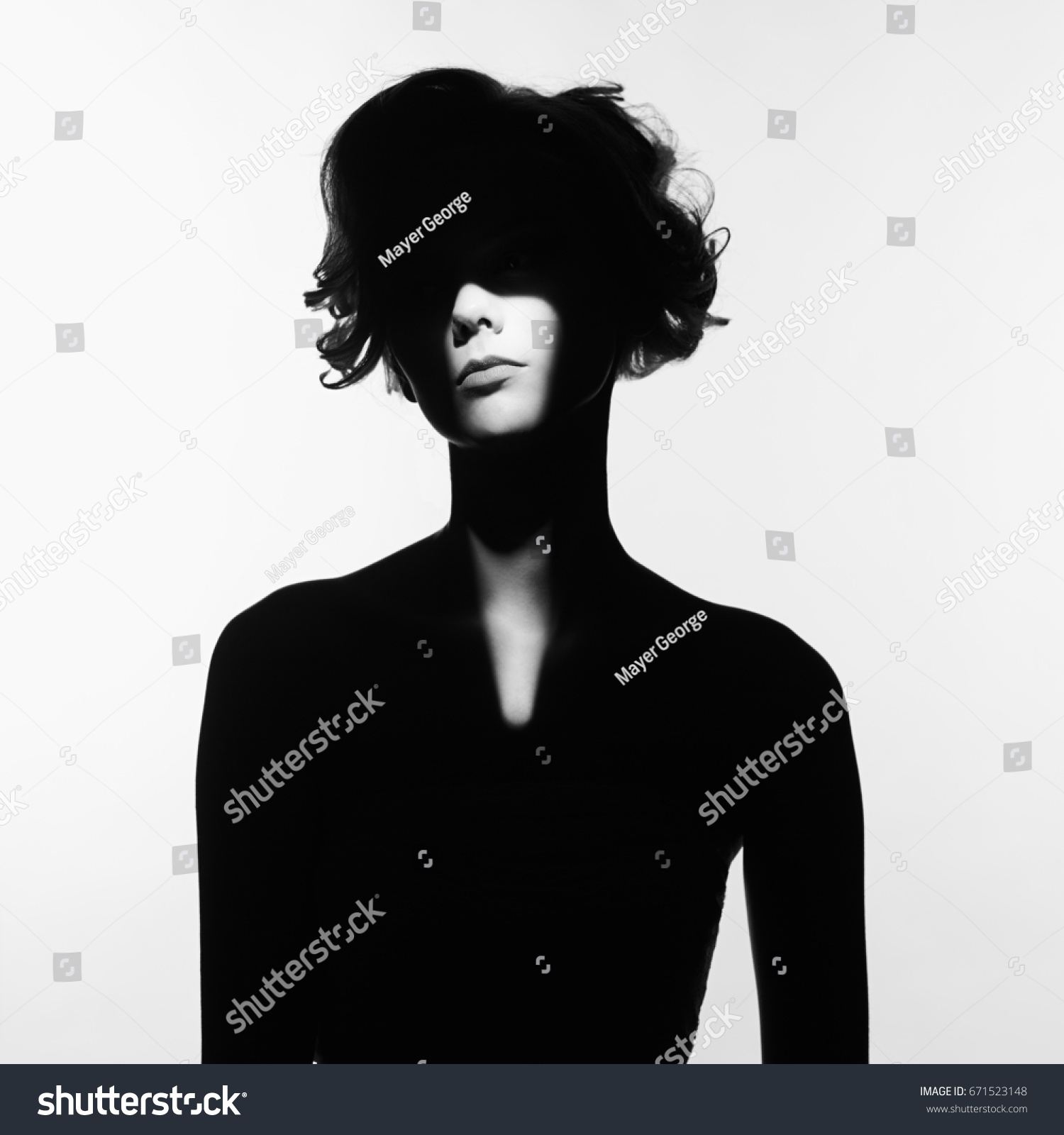 Black and white art fashion surrealistic portrait of beautiful woman with a beam of light on