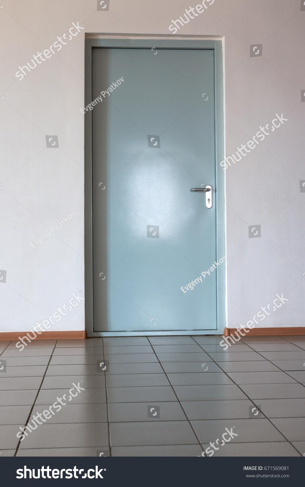 Door on the wall in an office room tiled floor | EZ Canvas