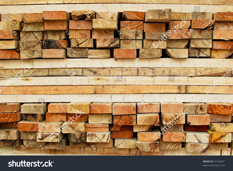 Stack lumber timber logs storage construction stock photo