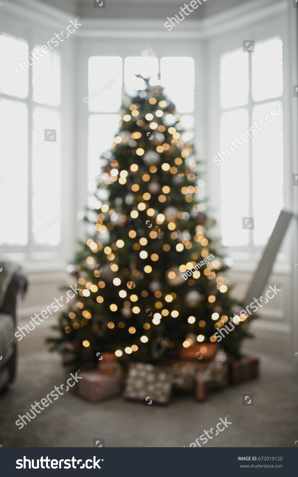 Defocused Christmas Tree In A Living Room With Presents Underneath It. Part 74