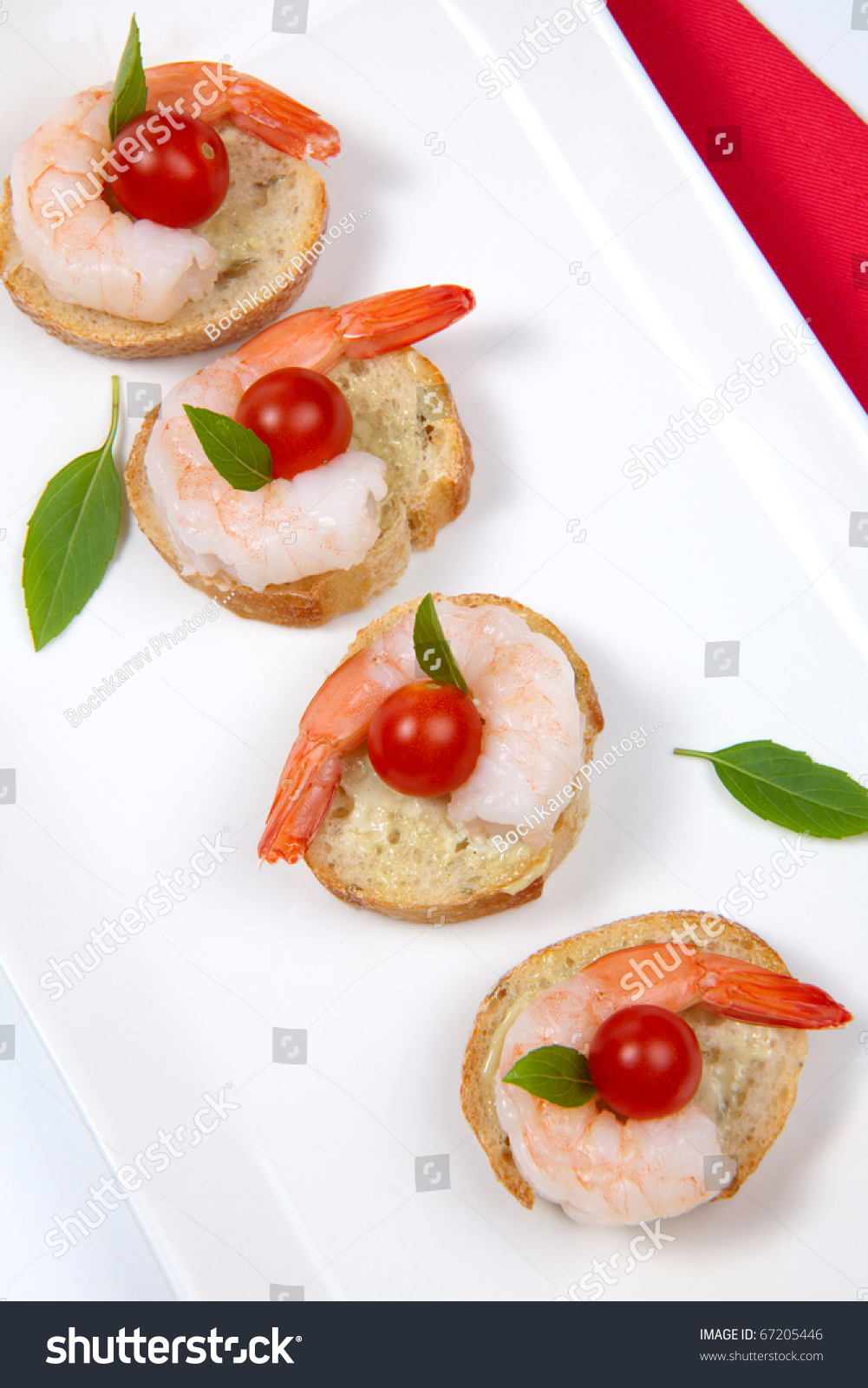 Closeup of delicious shrimp canape with cherry tomatoes for Canape spreaders