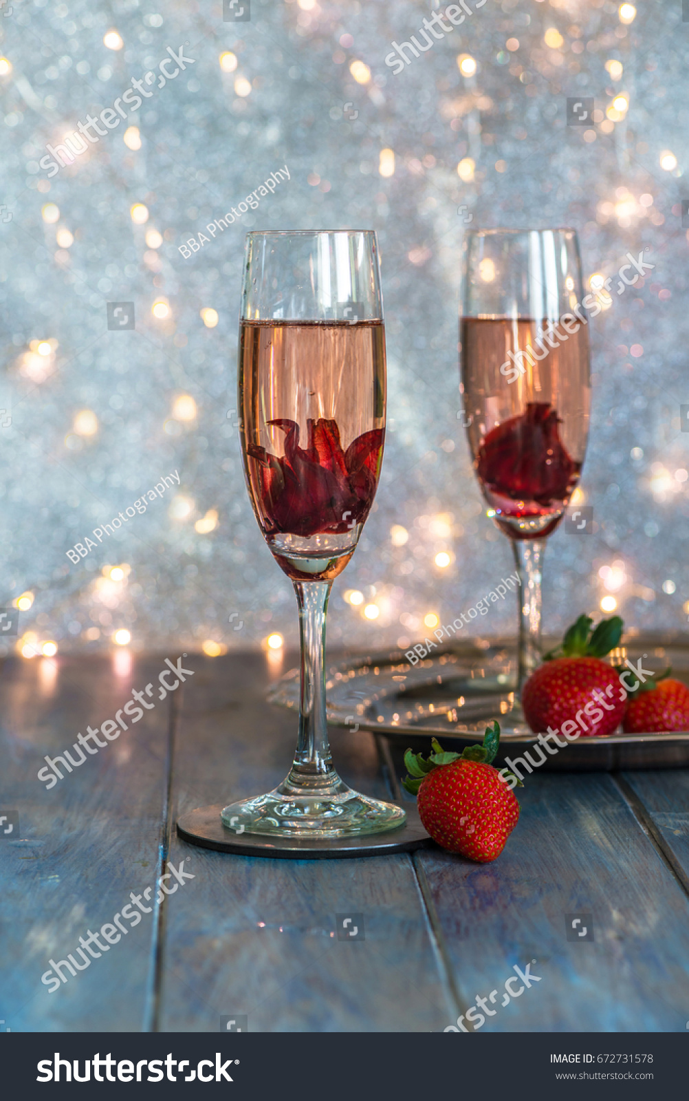 Champagne glasses hibiscus flower inside strawberries stock photo champagne in glasses with hibiscus flower inside and strawberries on festive background izmirmasajfo