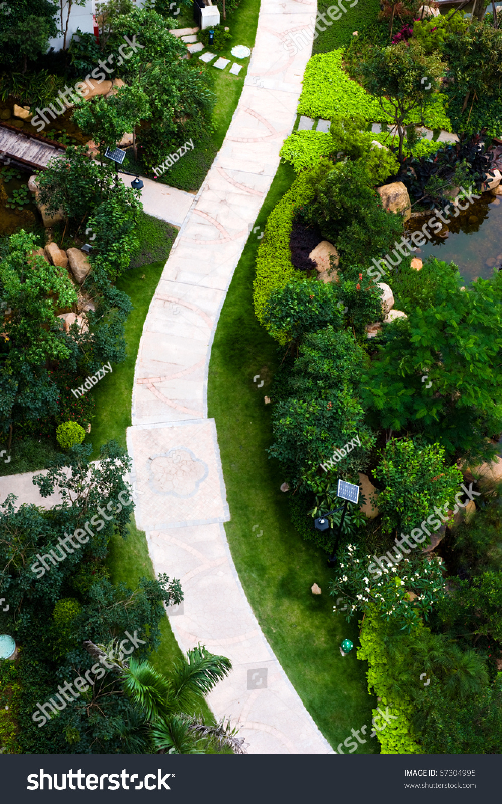 Top View Of Curve Brick Path In Garden, And Surrounded By