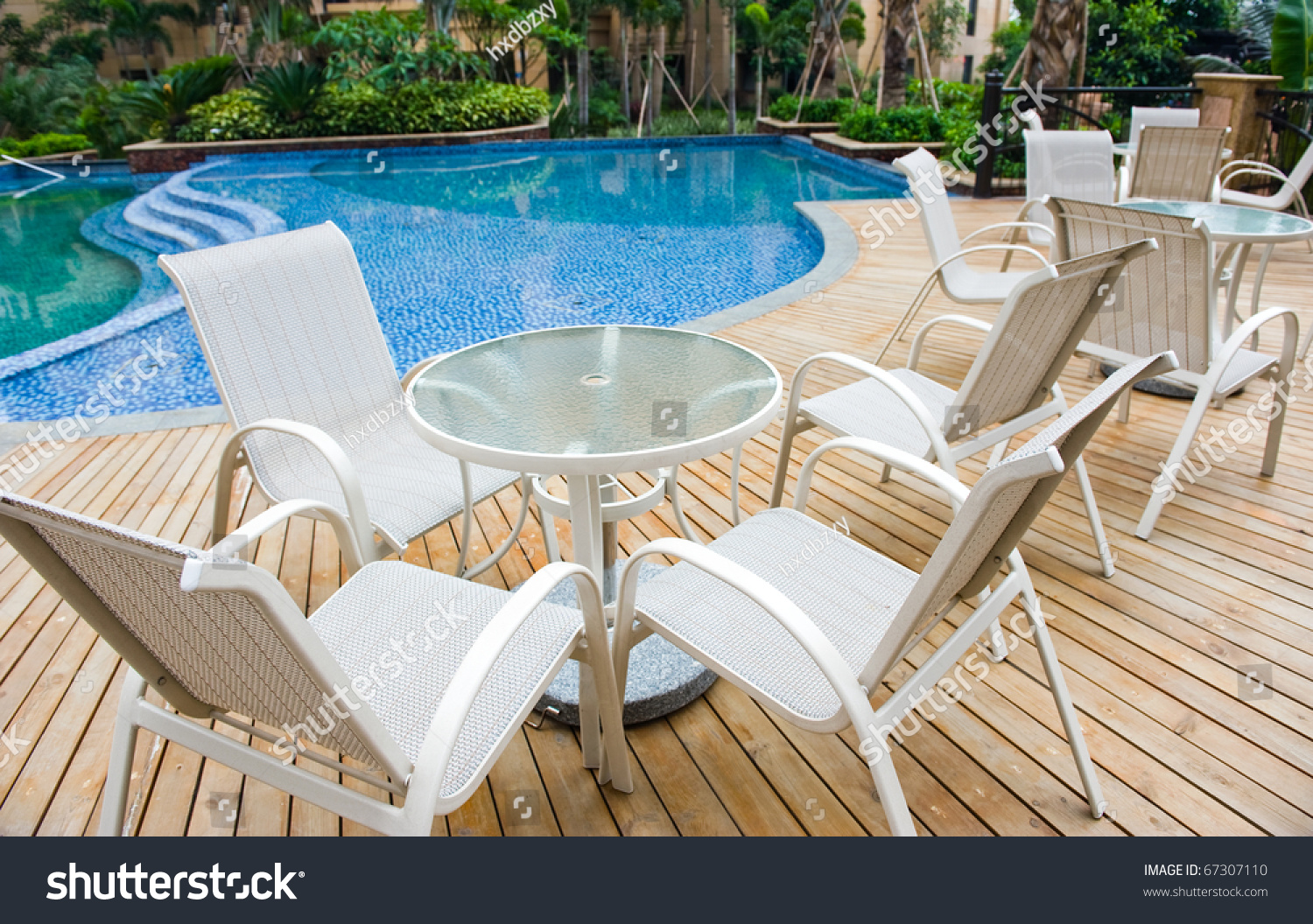 Chairs And Tables Next To A Swimming Pool Stock Photo 67307110 Shutterstock