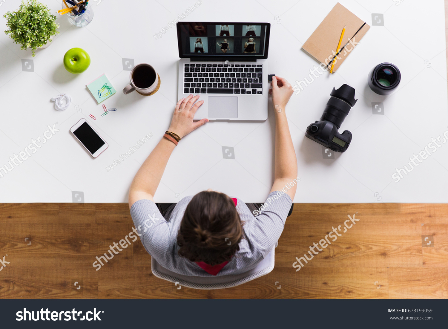 photography, people and technology concept - woman inserting camera flash drive into laptop computer at office table #673199059
