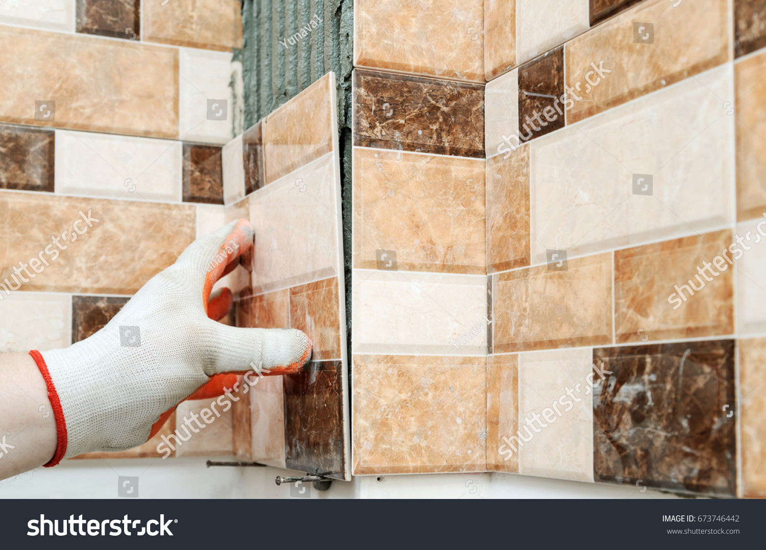 Installation ceramic tiles tilers hands fixing stock photo installation of ceramic tiles the tilers hands are fixing the tile and forming jolly edge dailygadgetfo Gallery
