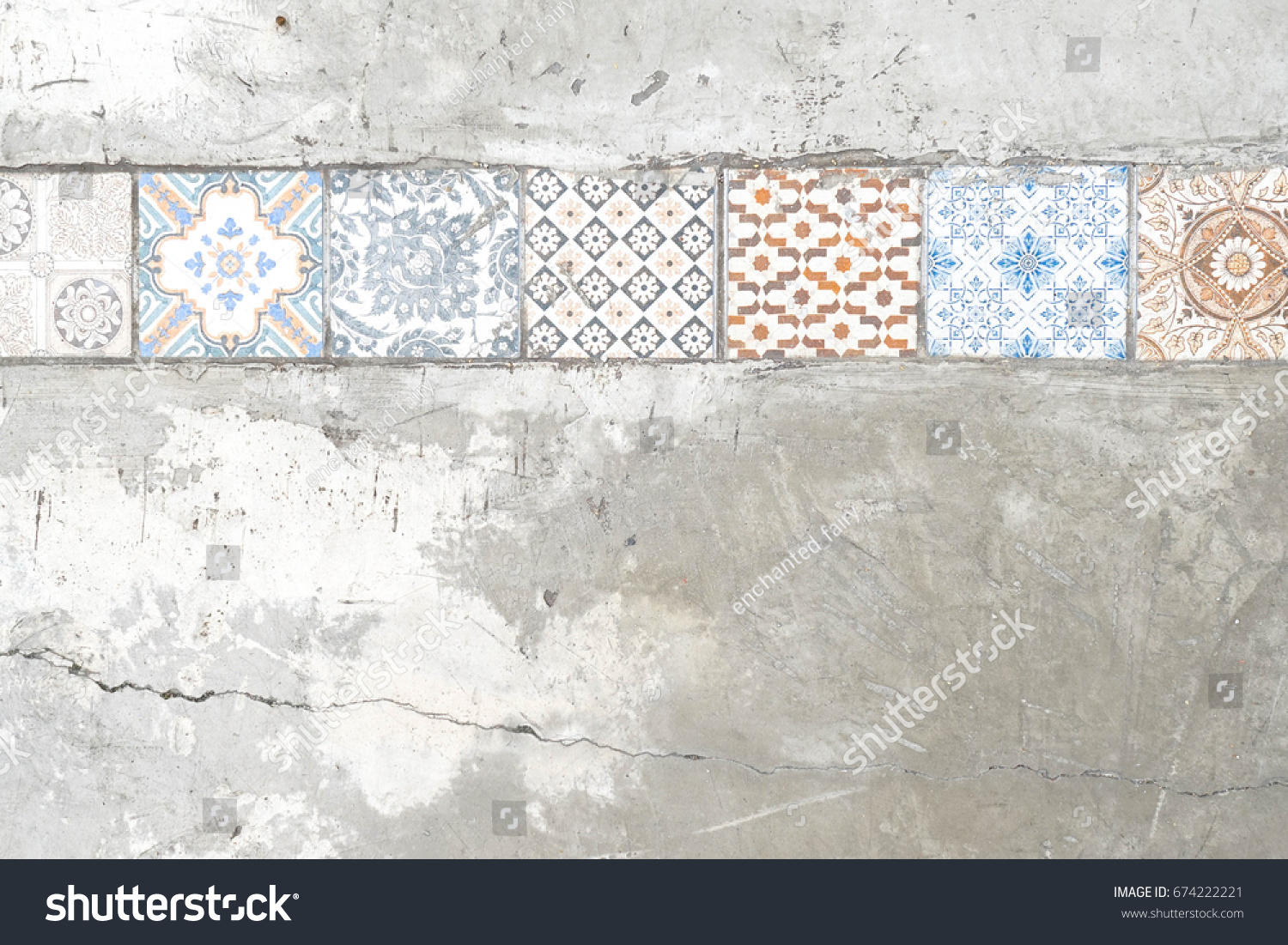 Old paving tiles pattern on concrete stock photo royalty free old paving tiles pattern on the concrete or cement wall with cracks ceramic tile pattern dailygadgetfo Choice Image