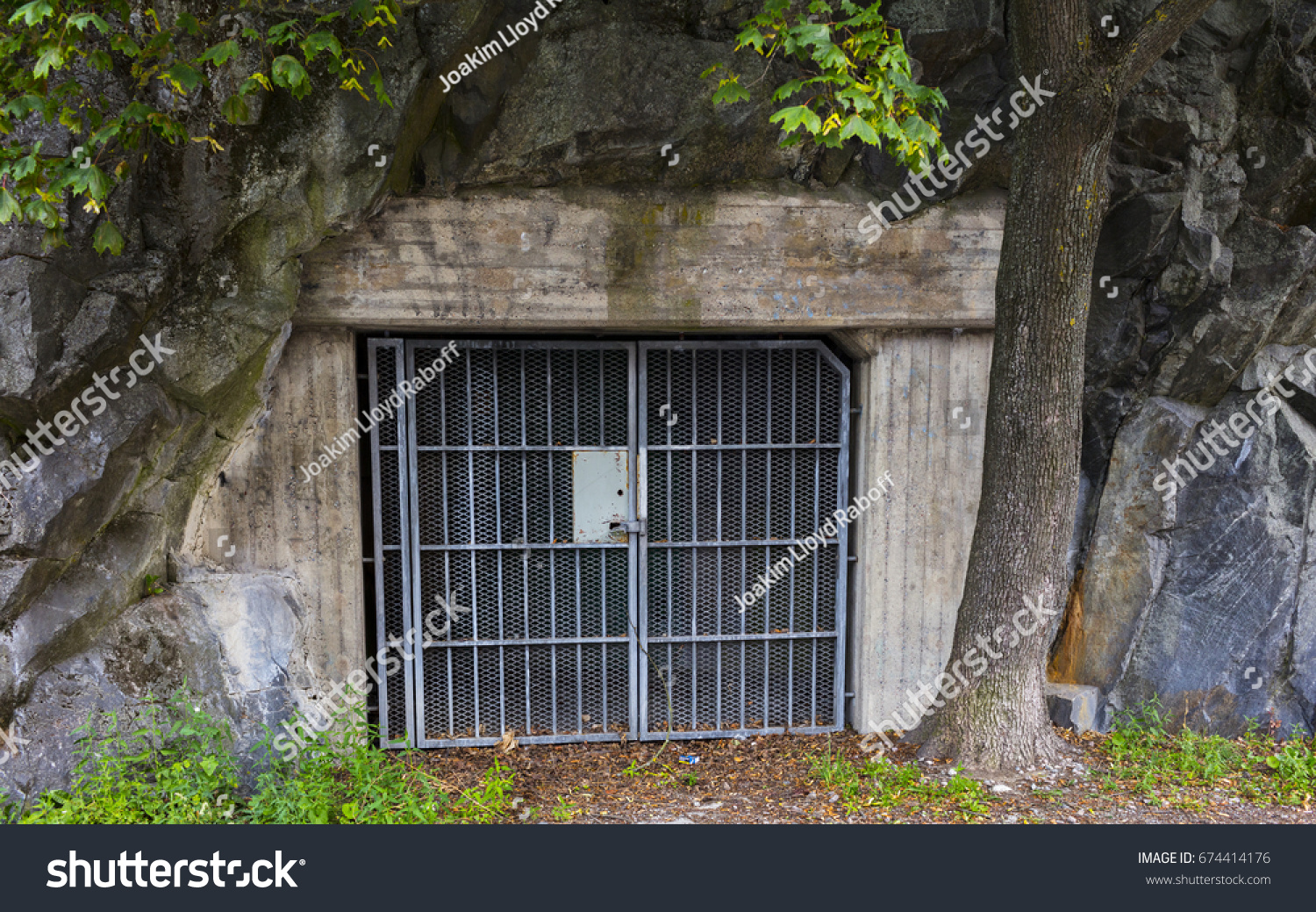 A locked metal gated door at the entrance to a vintage bunker or shelter built & Locked Metal Gated Door Entrance Vintage Stock Photo 674414176 ...