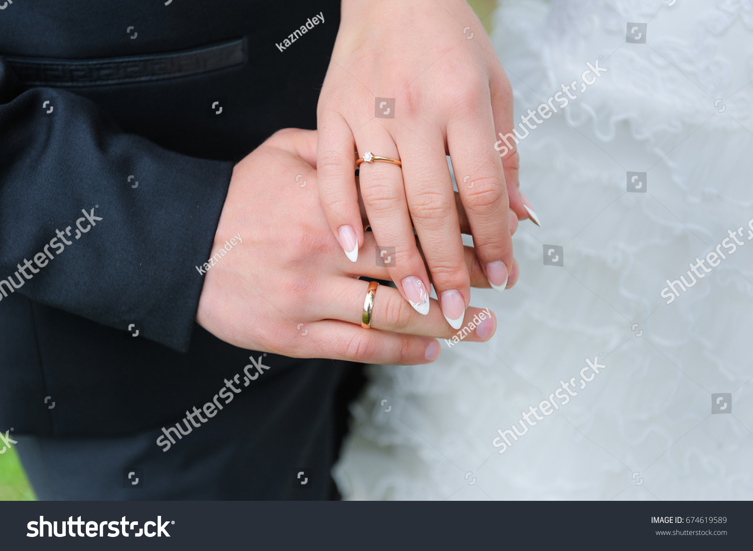 Holding Hands Wedding Rings Stock Photo (Royalty Free) 674619589 ...