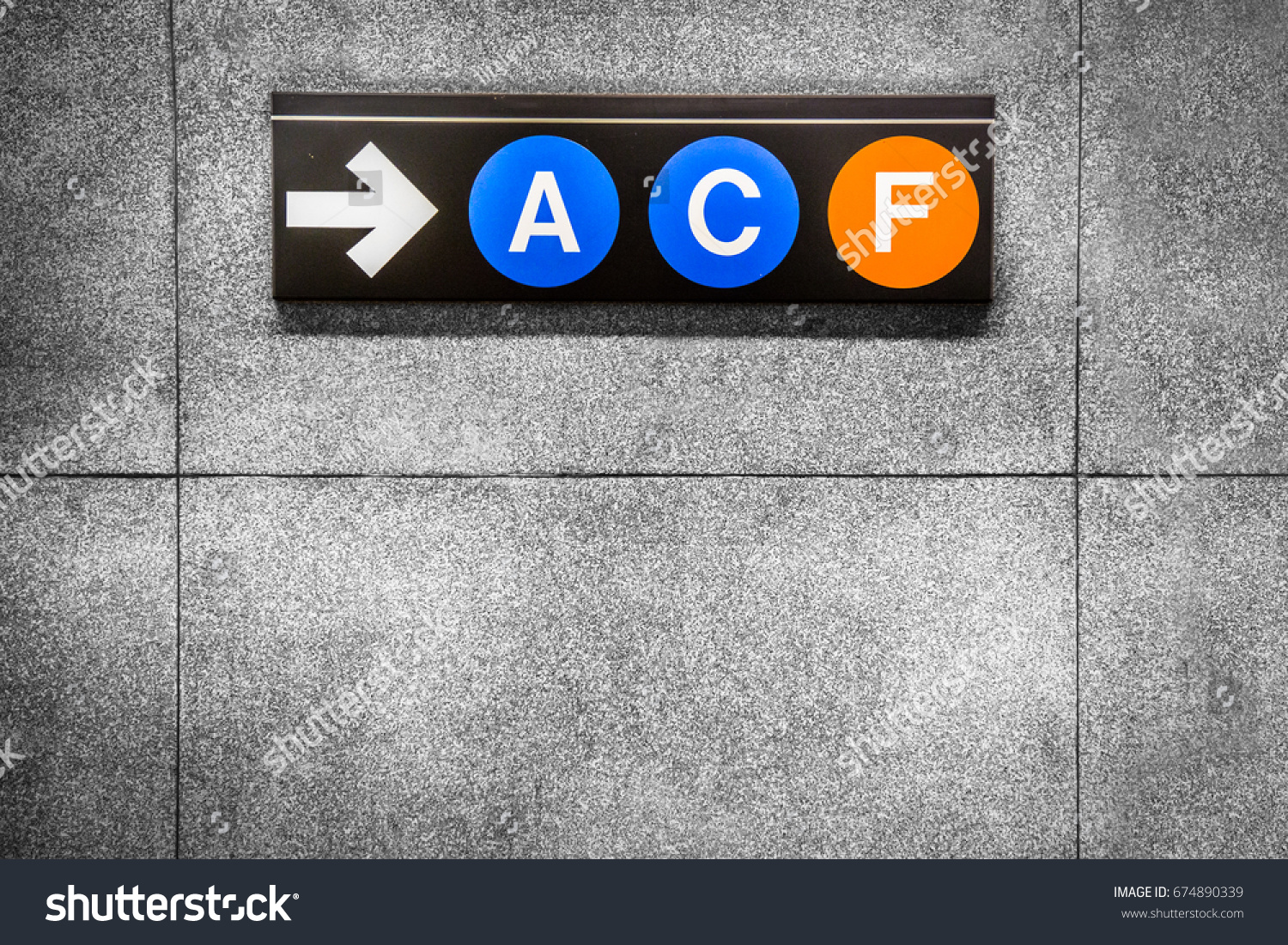 Sign new york city subway circle stock photo 674890339 shutterstock sign for new york city subway with circle letters on interior wall biocorpaavc Gallery