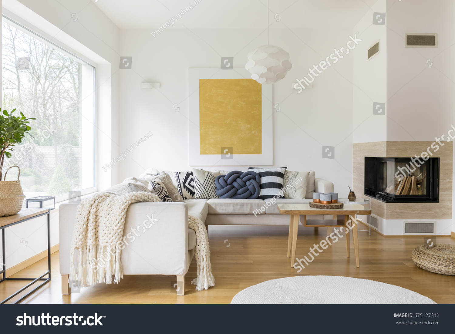 white sofas in living rooms. White sofa with pillows and modern fireplace in stylish living room Sofa Pillows Modern Fireplace Stylish Stock Photo 675127312