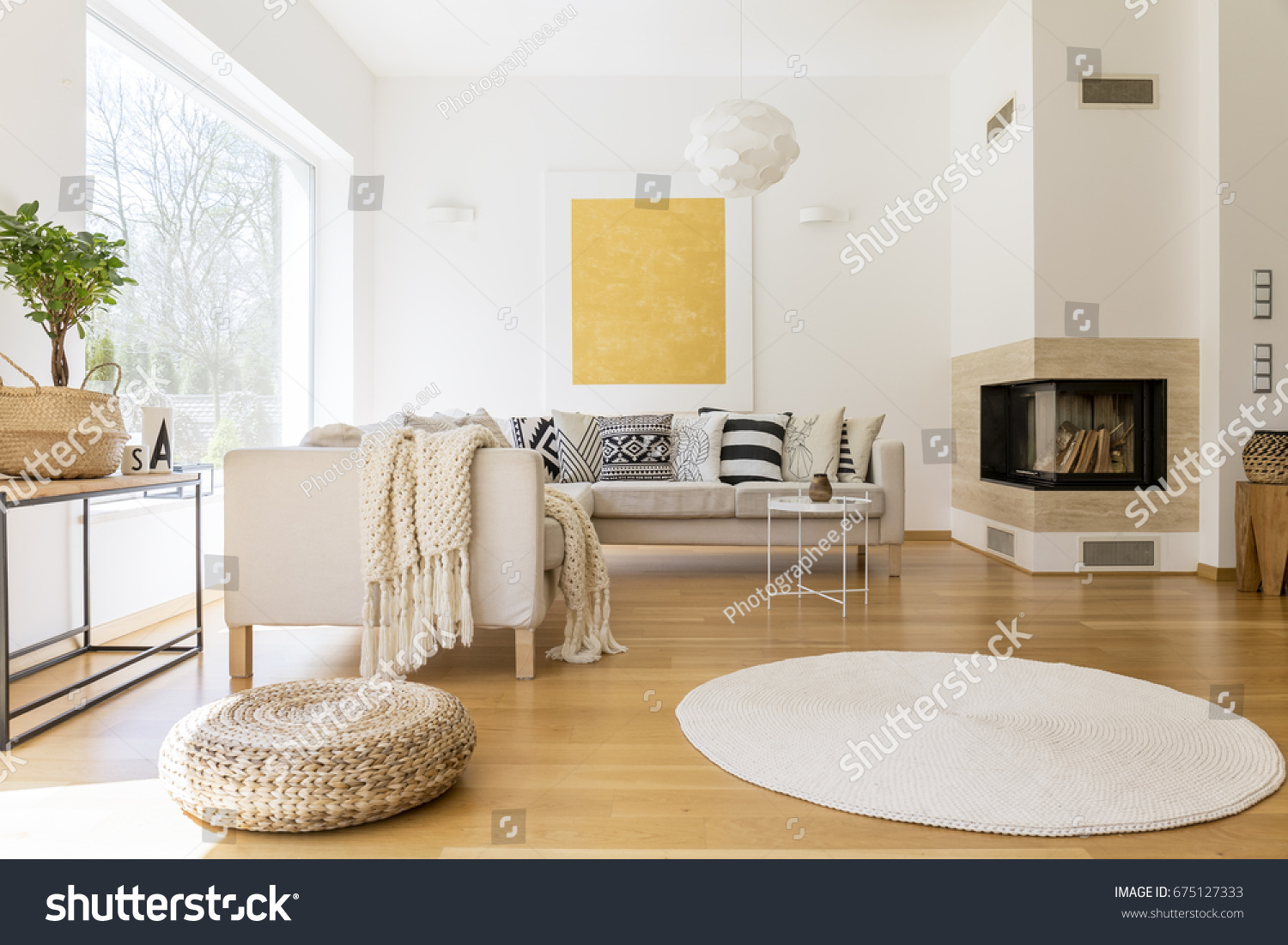 Spacious white and wooden living room with modern fireplace and sofa #675127333