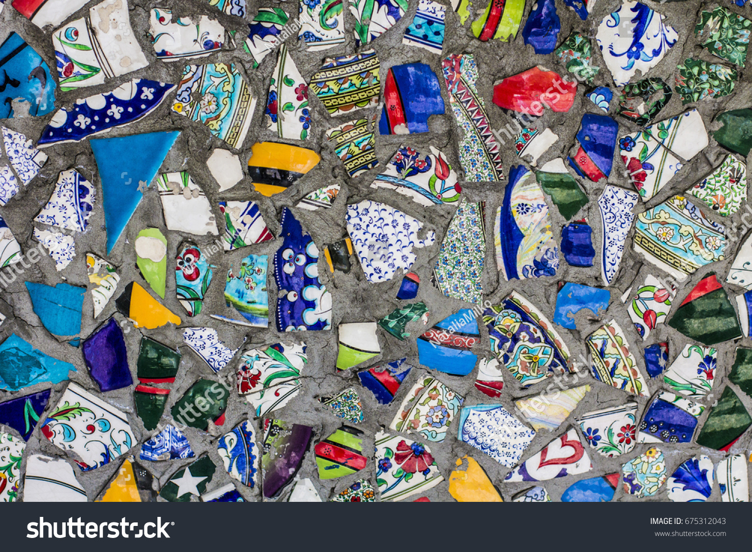 Mosaic broken ceramic tiles on wall stock photo royalty free mosaic of broken ceramic tiles on the wall of the building in istanbul center turkey dailygadgetfo Images