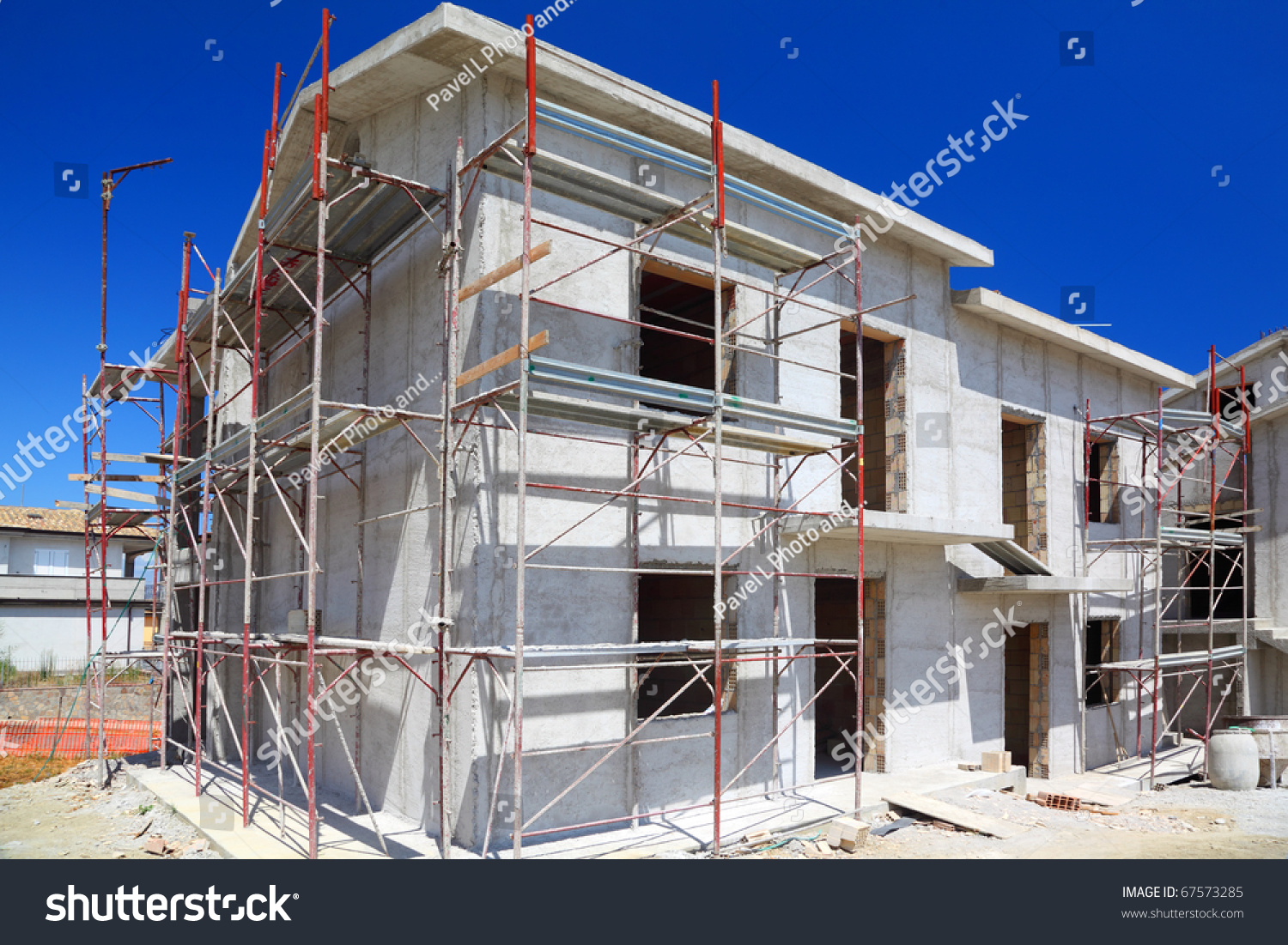 Construction of building of new two story white concrete for Building a 2 story house