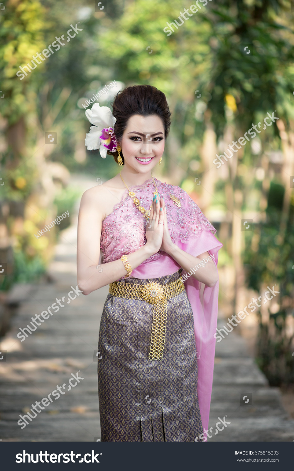 Beautiful thai girl thai traditional costume stock photo 675815293 beautiful thai girl in thai traditional costume in thais greeting gesture kristyandbryce Images