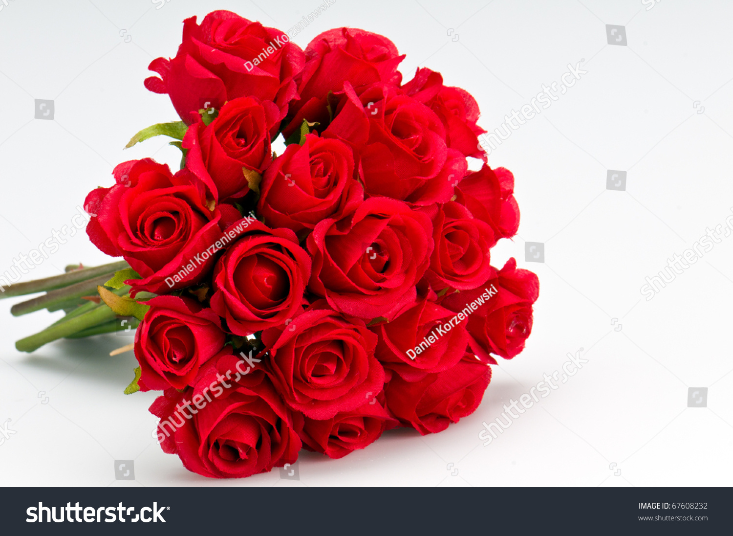 Bouquet artificial red roses isolated space stock photo