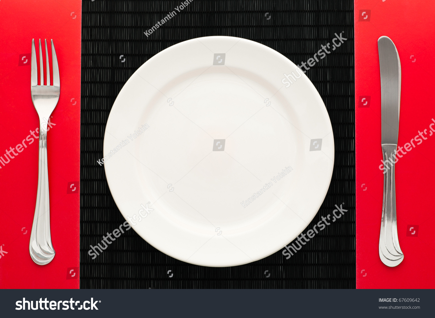 Empty White Plate On Black Table Stock Photo 67609642