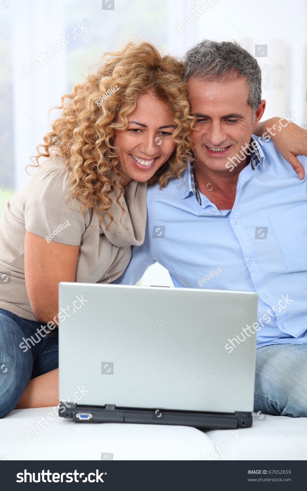 Couple surfing on internet at home #67652659