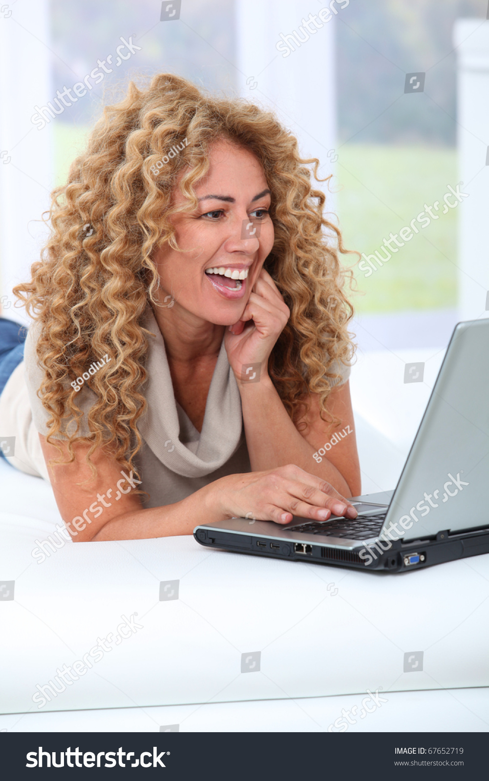 Woman at home using laptop computer #67652719