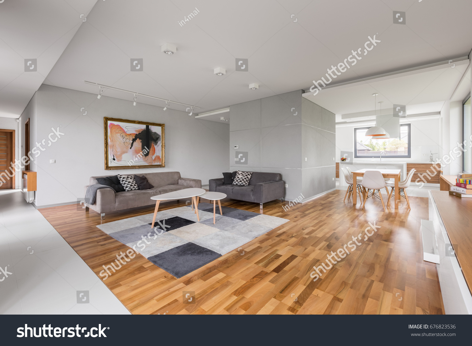 Modern apartment with open living room, kitchenette and dining area #676823536