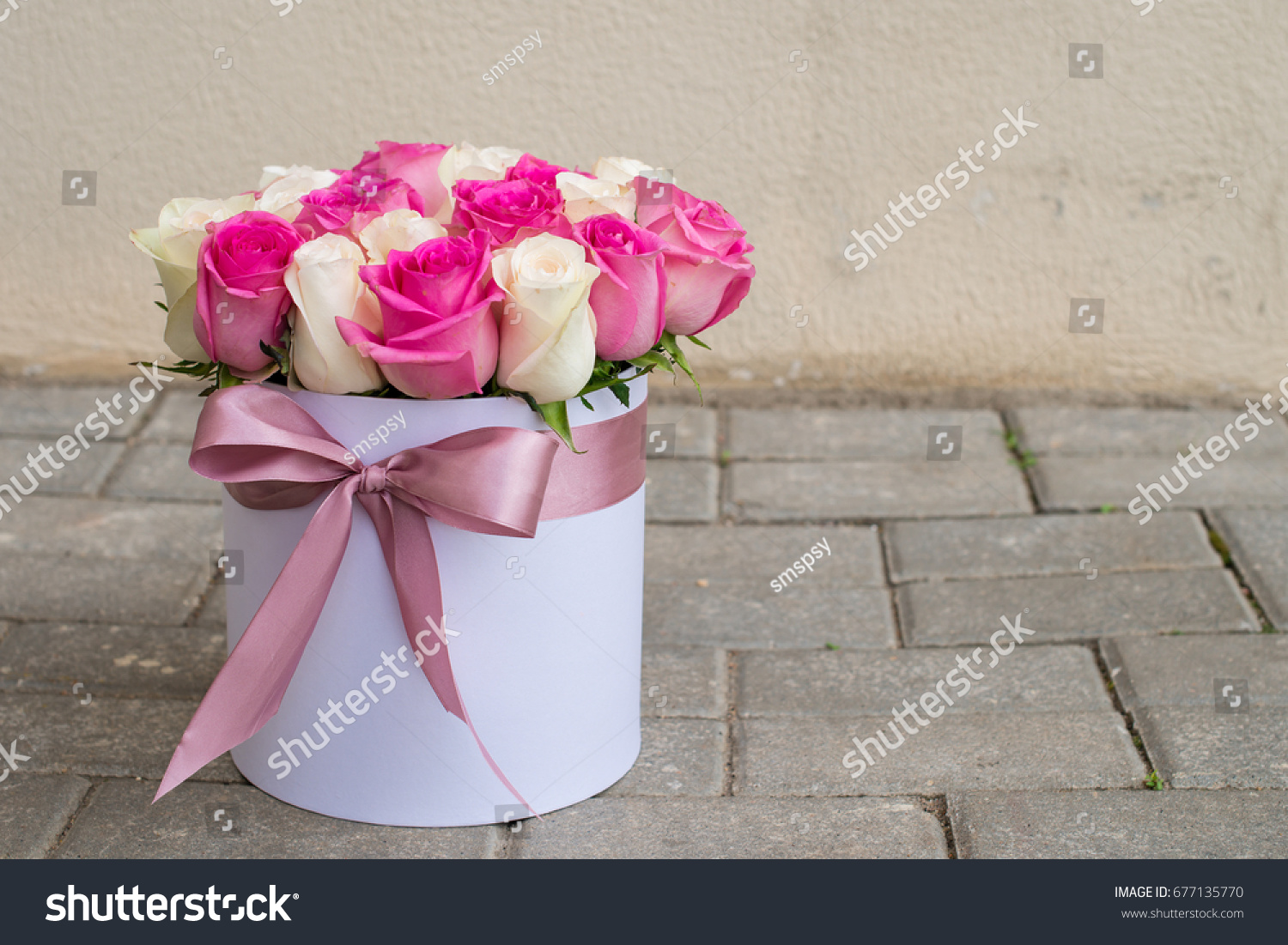 Gift box beautiful bouquet blooming pink stock photo royalty free gift box with beautiful bouquet of blooming pink and white roses and ribbon standing on the izmirmasajfo