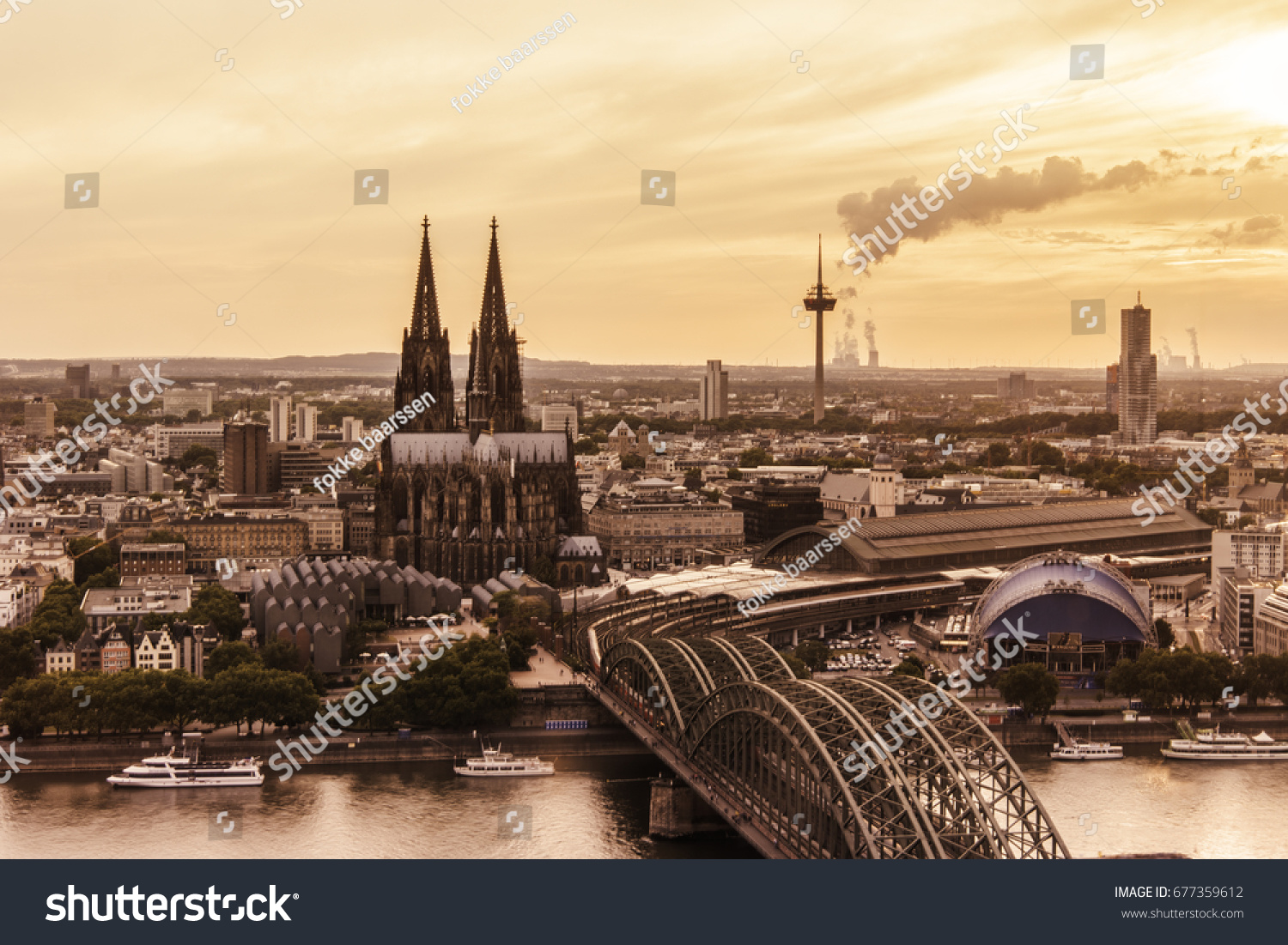 evening scene over cologne koln city with kolner dom cathedral behind the hohenzollern bridge