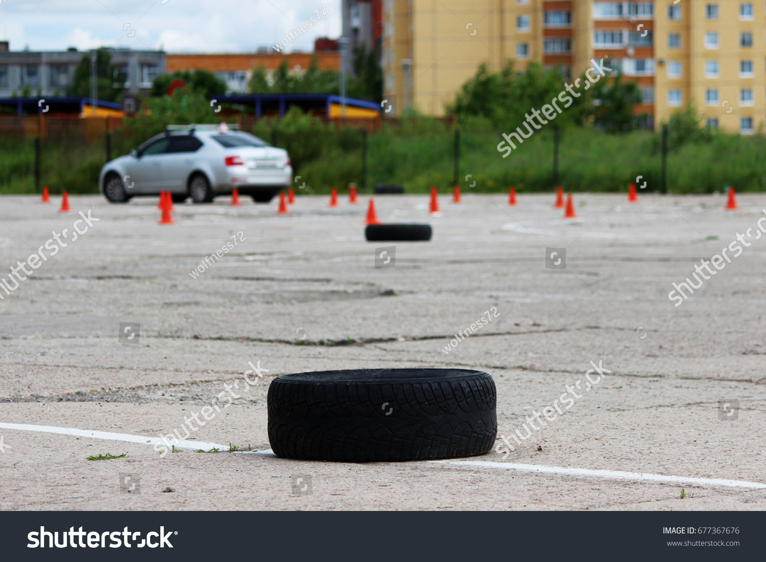 many plastic signaling traffic cones and Rubber tires from wheels are on site for training where drivers learn to ride on cars. #677367676