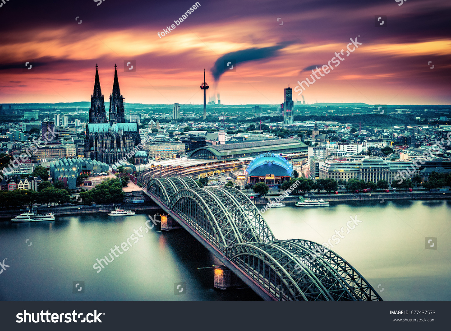 long exposure sunset moving clouds over the city cologne germany evening scene over cologne