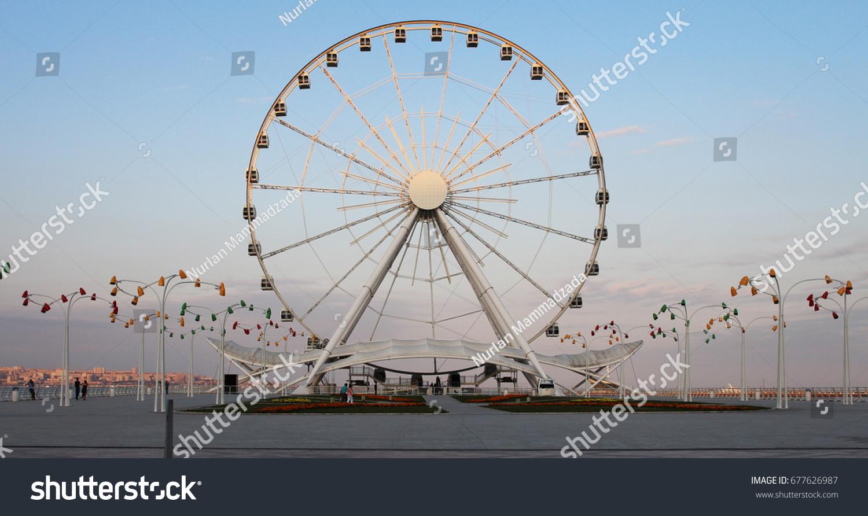 Ferris wheel in front of sky. Big carousel in Baku #677626987