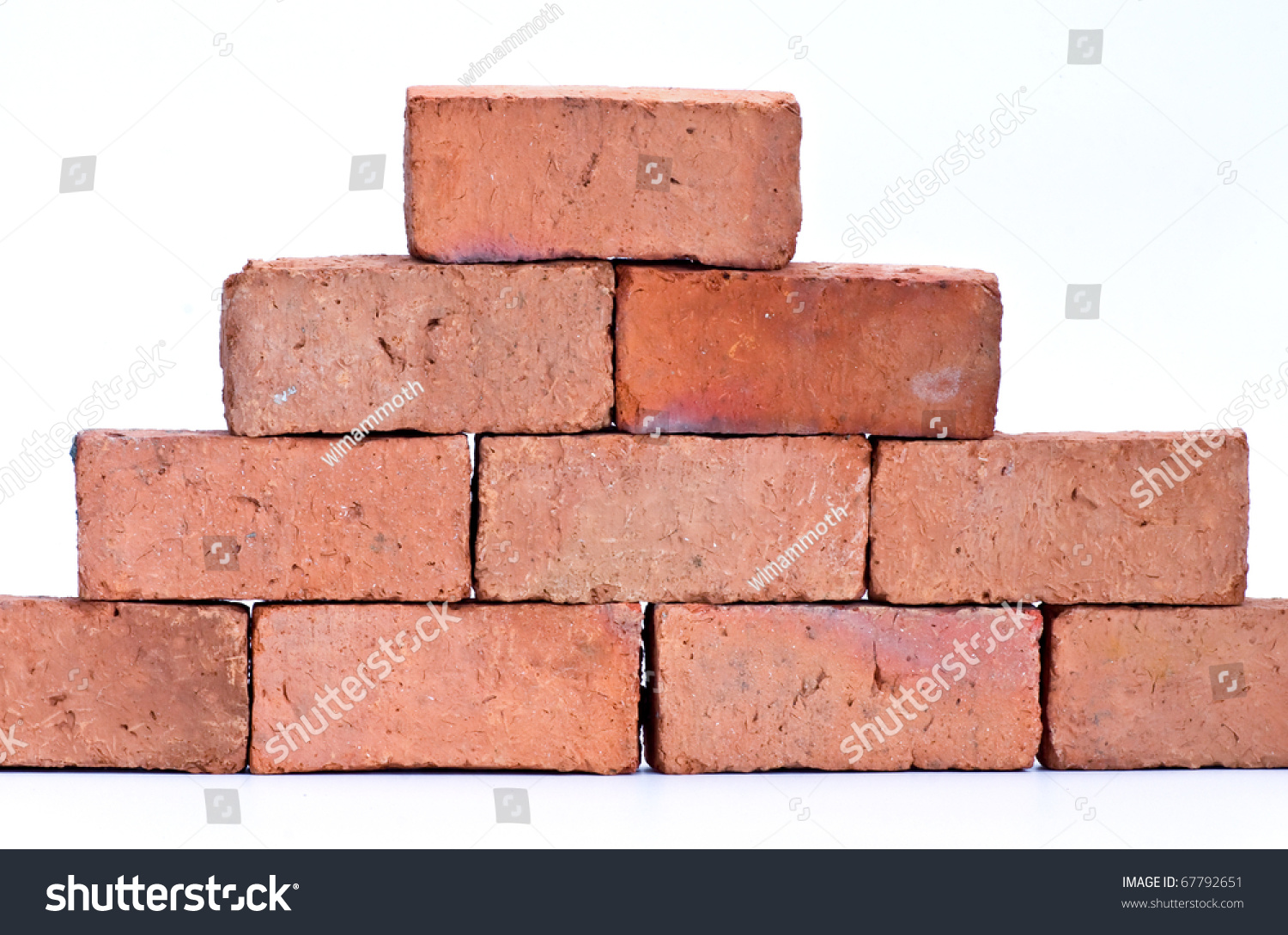 Red Clay Bricks : Red clay brick isolated on white stock photo