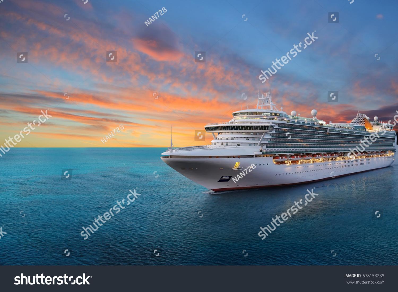Luxury cruise ship sailing to port on sunrise  #678153238