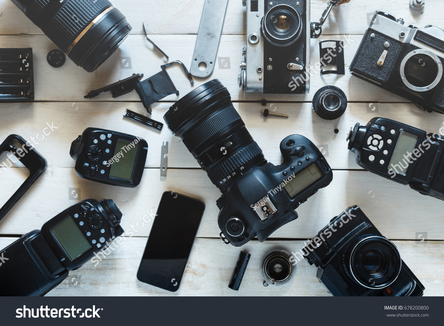 Vintage Film Camera, Digital Camera And Smartphone On White Wooden Background Technology Development Concept. Top View #678200800