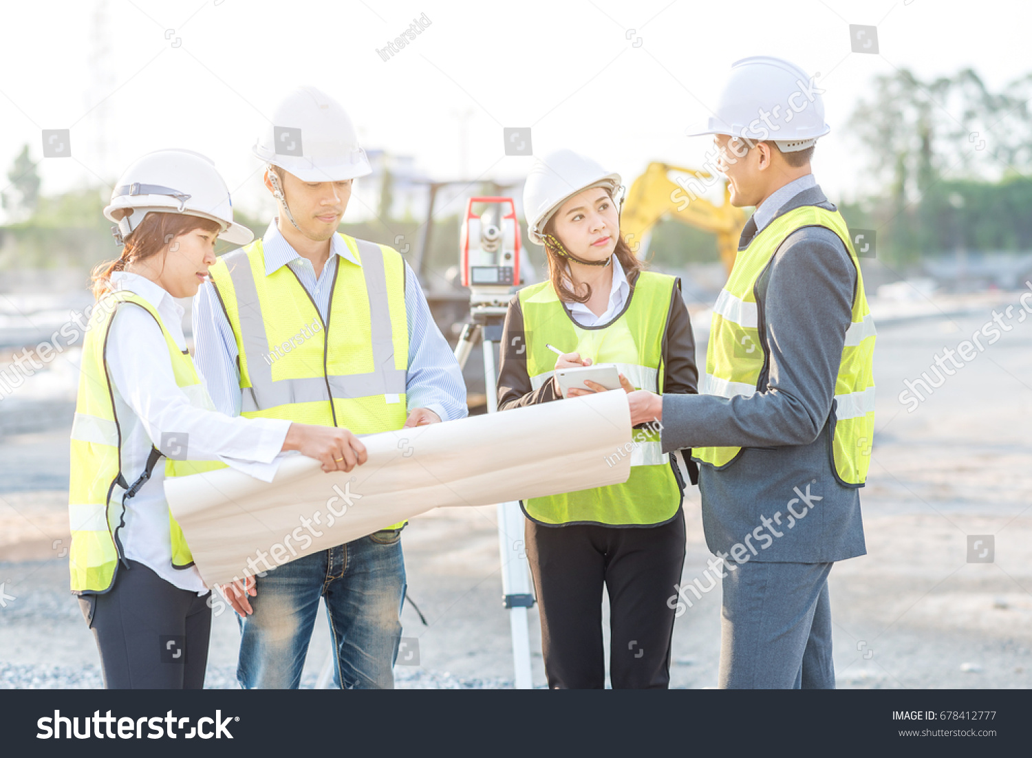 Businessman engineer builder review blueprint during stock photo businessman engineer and builder review blueprint during team meeting at construction site in the morning with malvernweather Image collections