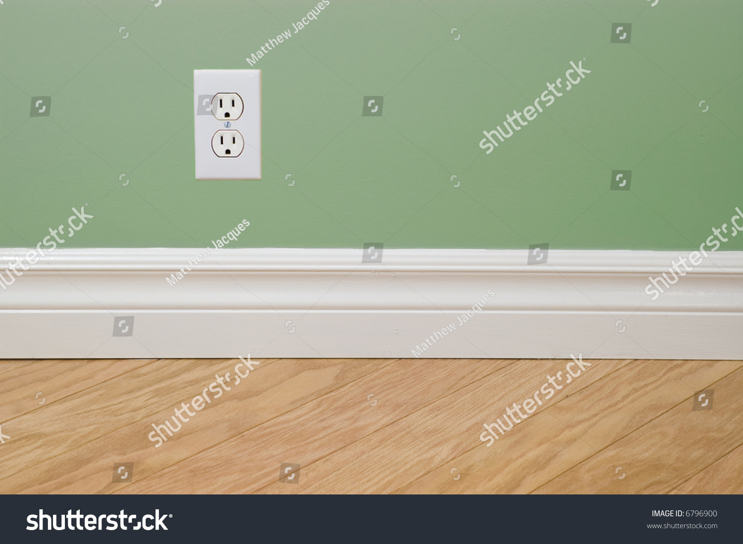 Power outlet on green wall hardwood stock photo 6796900 for Zap wood floor cleaner