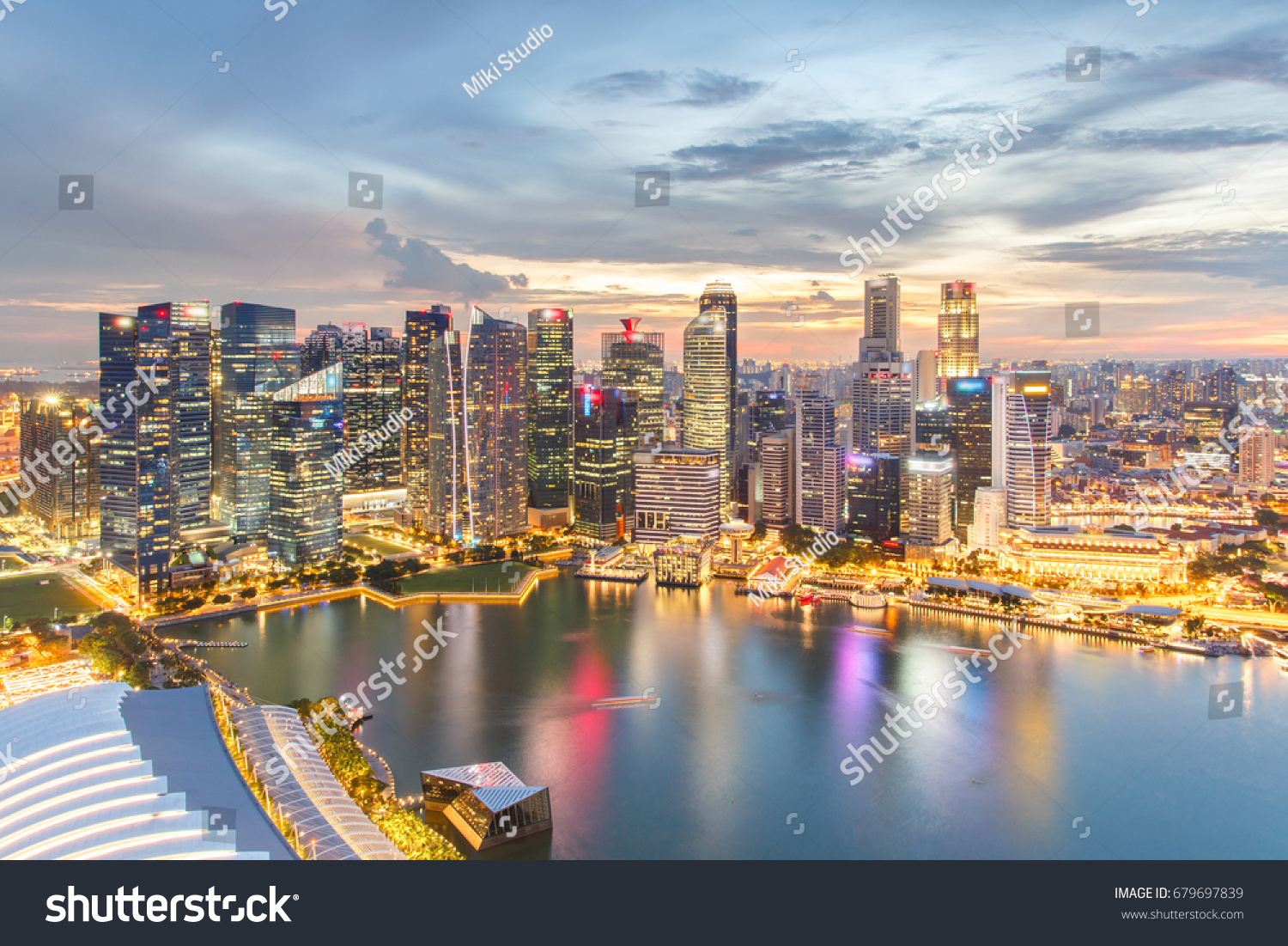 Colorful lights architecture business building and financial district in sunset time at Singapore City. #679697839