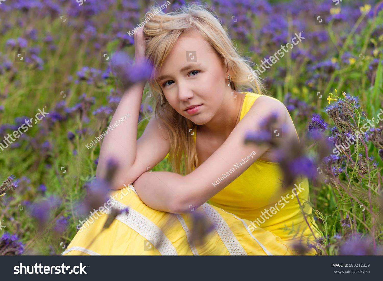 Beautiful young girl yellow dress blooming stock photo royalty free beautiful young girl yellow dress blooming stock photo royalty free 680212339 shutterstock mightylinksfo
