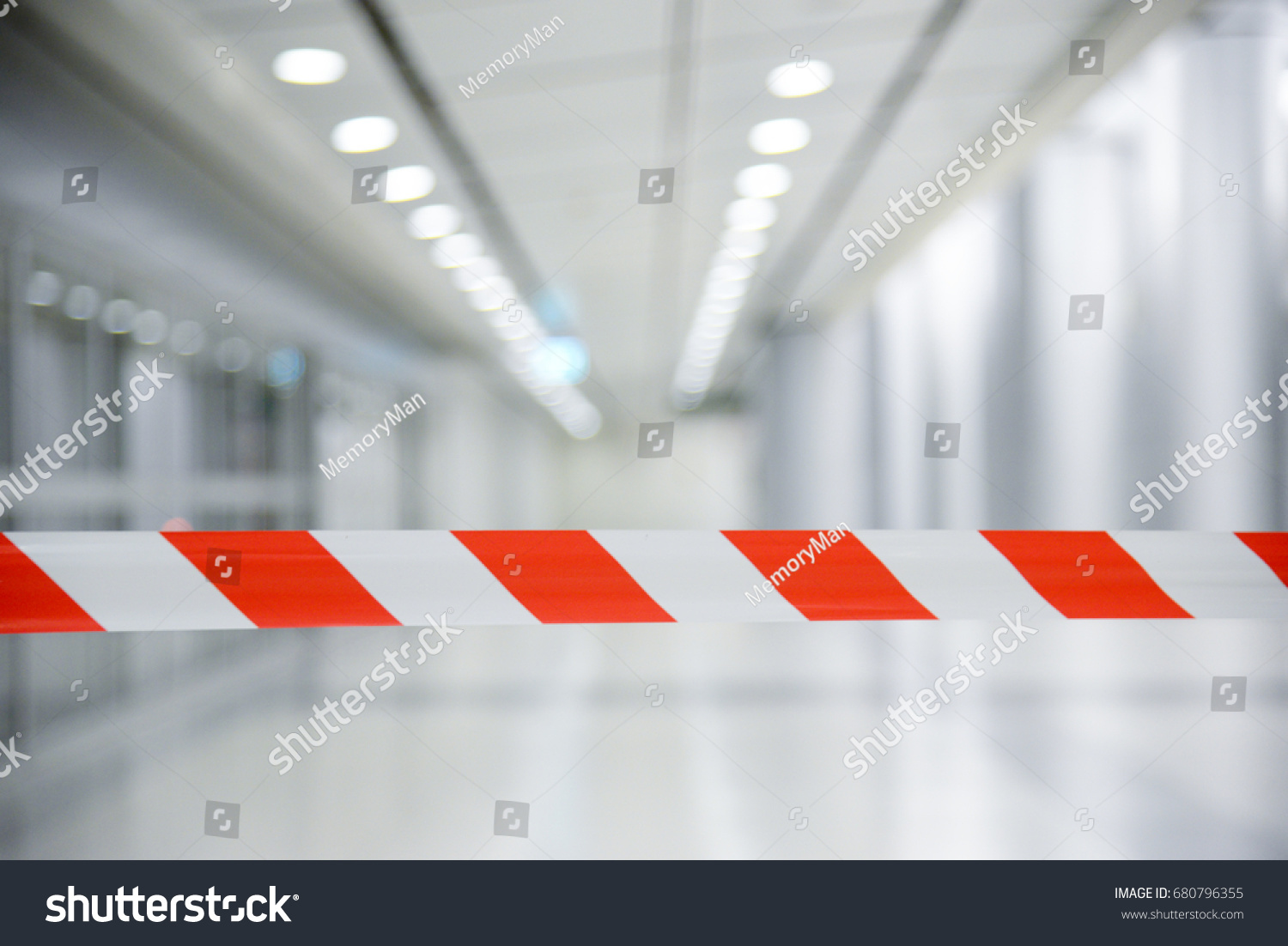 Red and White Lines of barrier tape. At subway station of airport background.Red White warning tape pole fencing is protects for No entry
