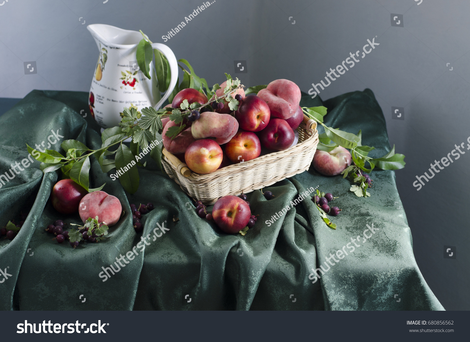 Still life with ripe peaches, berries lying on the table #680856562