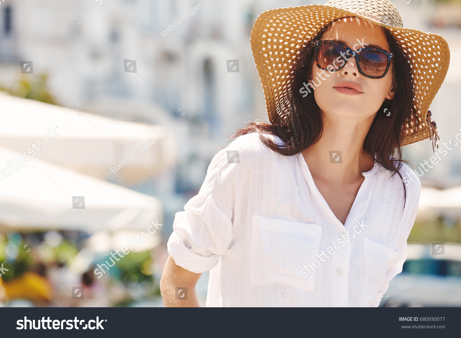 Young beautiful woman with sunglasses walking the streets of an Italian town #680930077