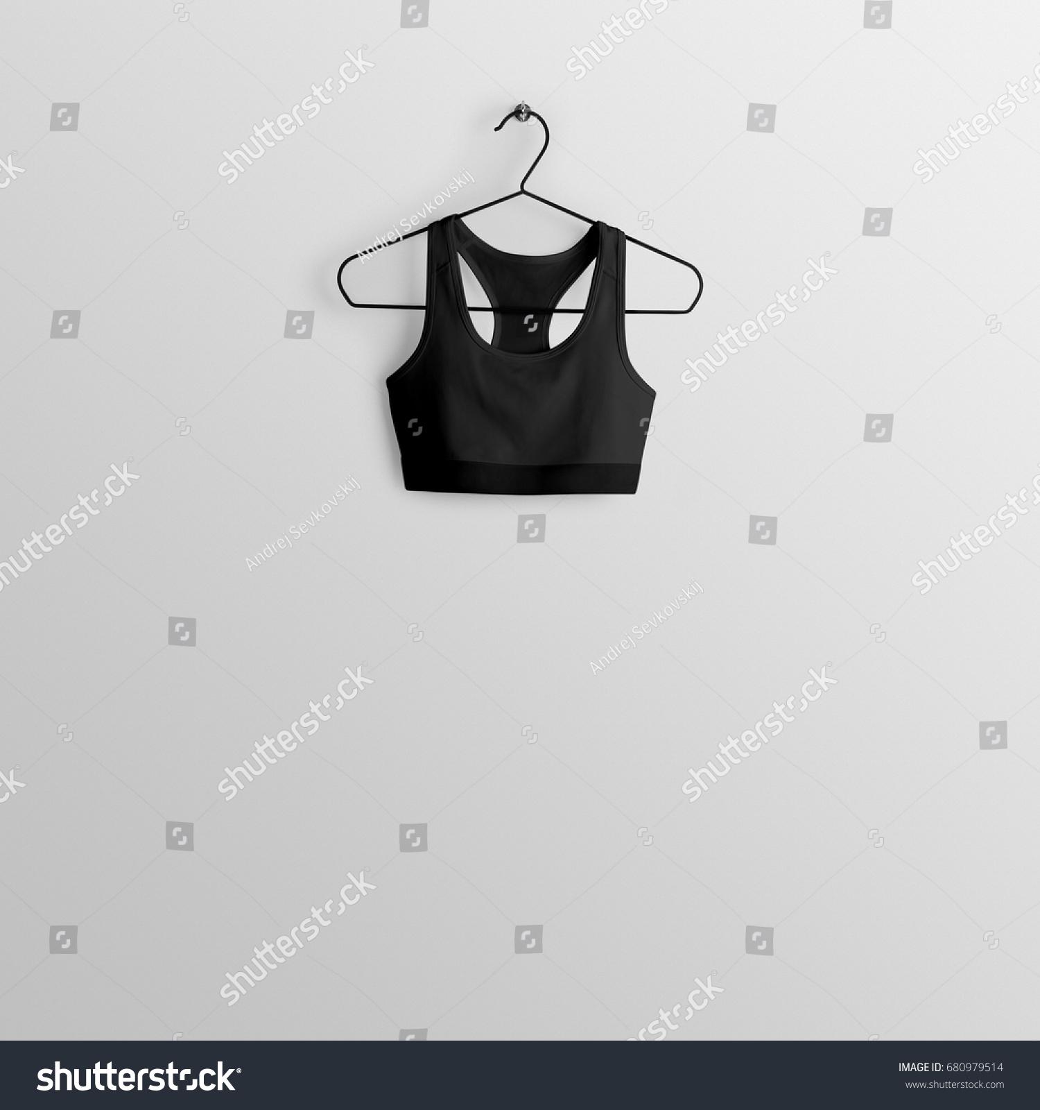 8c5eefac3e8eb Stock photo black sport bra crop top mockup on hanger hanging against empty  wall background jpg