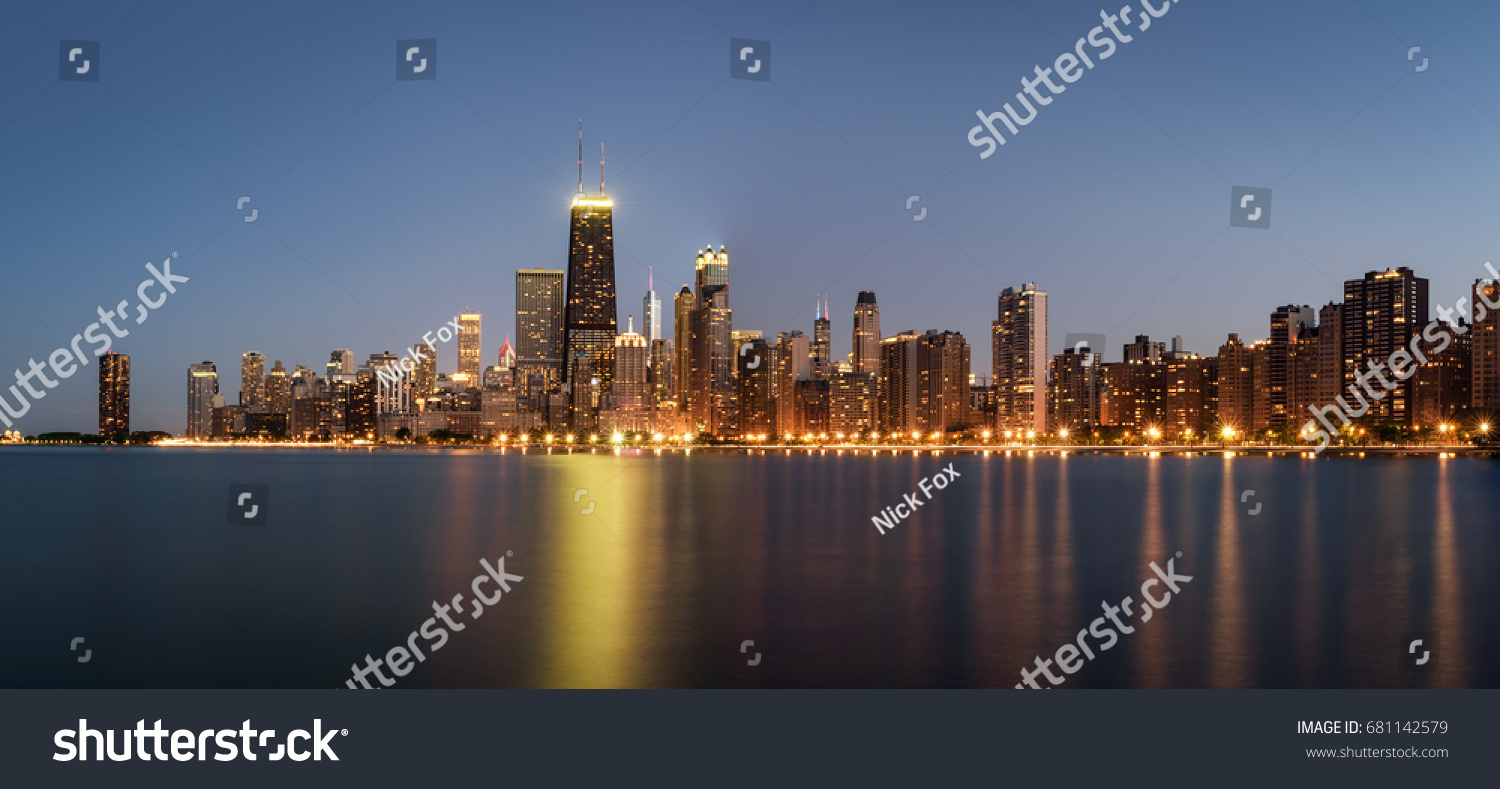 Chicago skyline panorama across Lake Michigan at night viewed from North Avenue Beach. Long exposure. #681142579