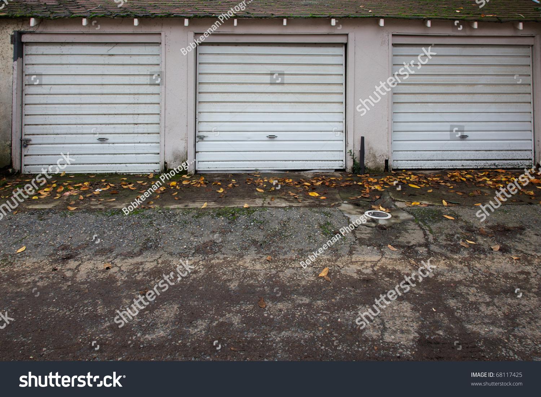 Three Old White Metal Garage Doors Stock Photo Edit Now 68117425