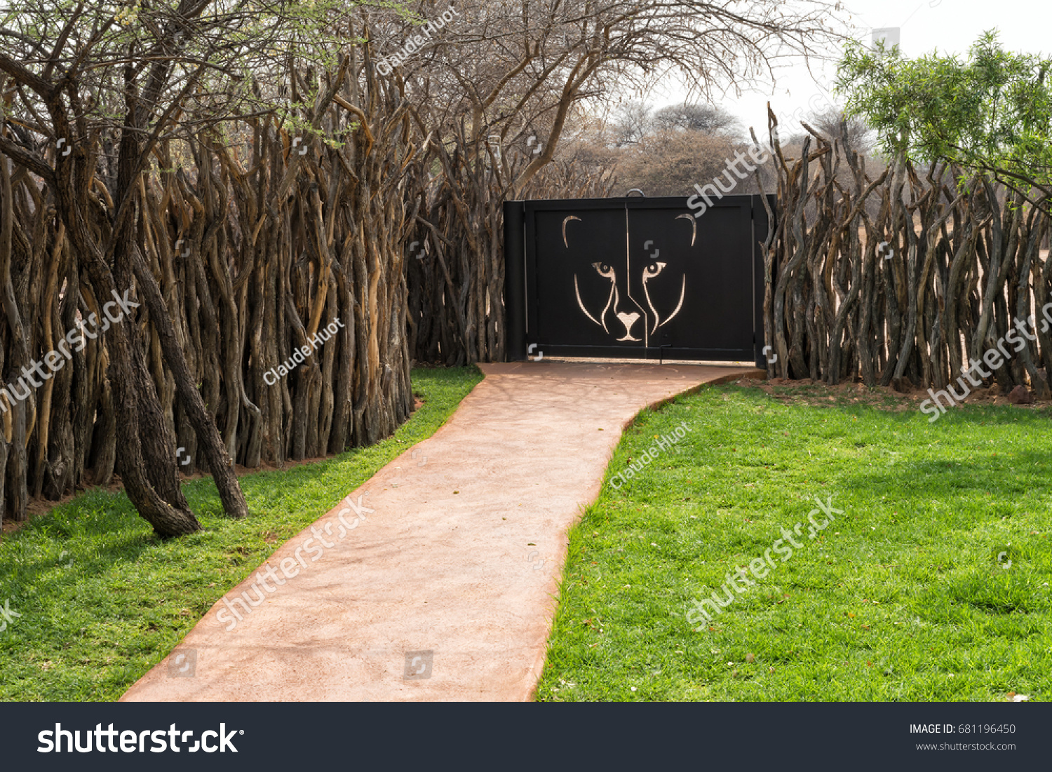OKONJIMA, NAMIBIA - SEPTEMBER 11, 2015: Pedestrian entrance gate to the Okonjima Lodge and the AfriCat Foundation. Their mission is the conservation of large cats through rehabilitation and education.
