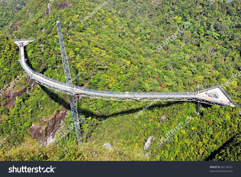 Curved Suspension Bridge Pedestrians On Gunung Stock Photo