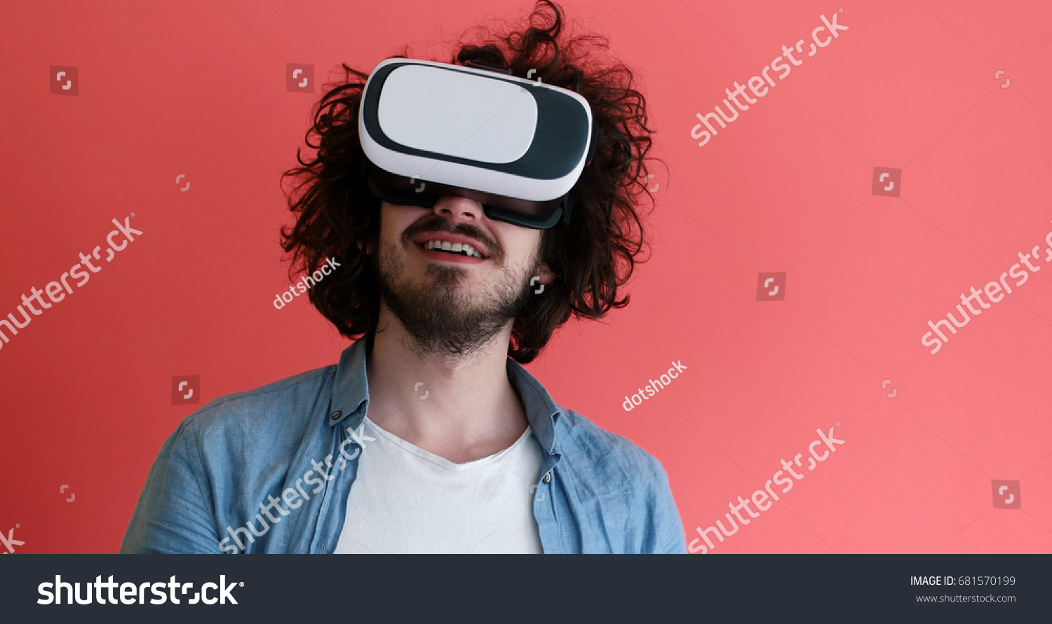 140aad206732 Happy man getting experience using VR headset glasses of virtual reality