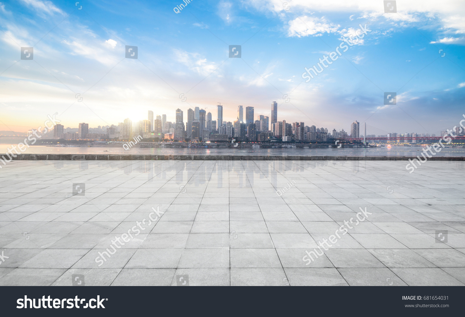 Panoramic skyline and buildings with empty concrete square floor #681654031