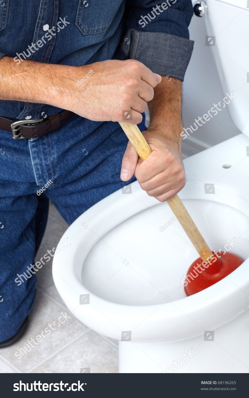 plumber with a toilet plunger stock photo 68196265 shutterstock. Black Bedroom Furniture Sets. Home Design Ideas
