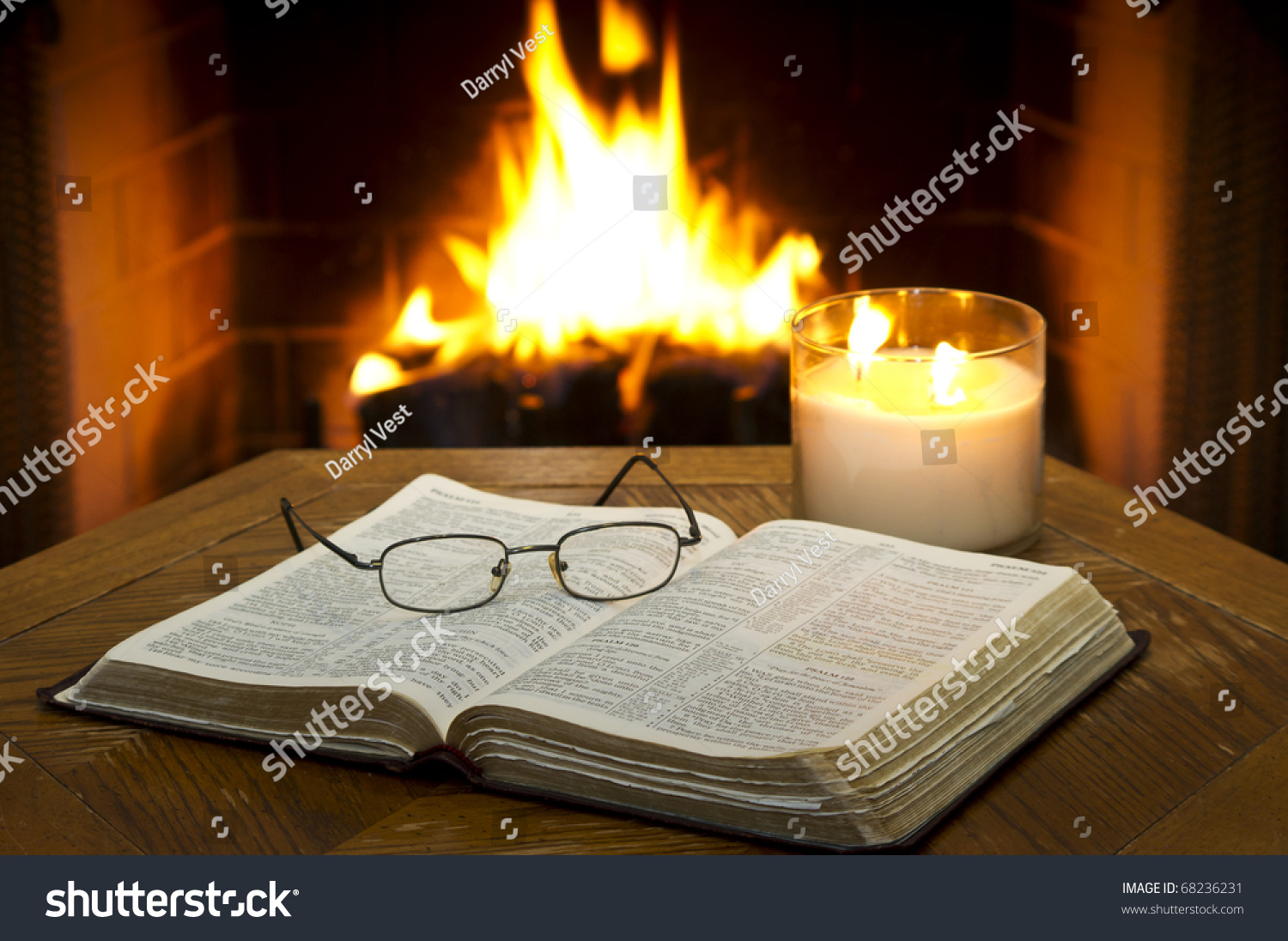open bible on table fireplace background stock photo 68236231