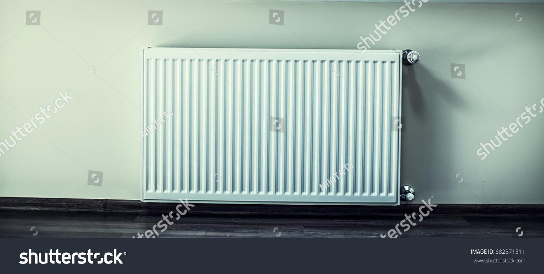 White radiator in an apartment. | EZ Canvas
